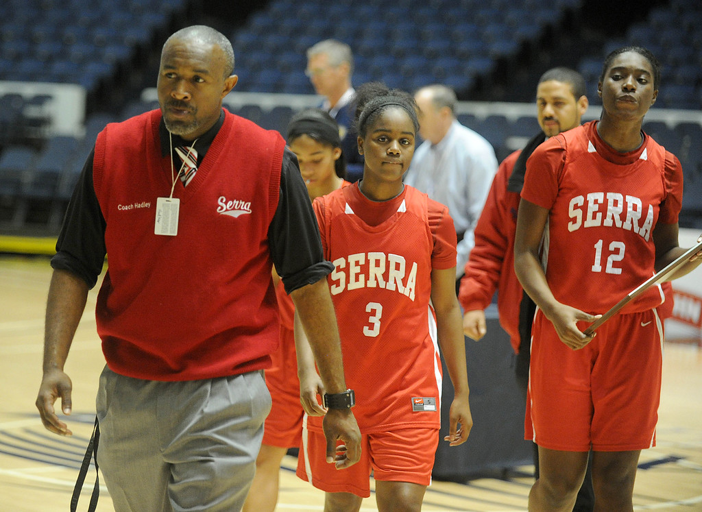 . 02-27-2012--(LANG Staff Photo by Sean Hiller)- Windward beat Serra 85-57 in Wednesday\'s girls basketball CIF SS Div. 4AA title game at the Anaheim Convention Center Arena in Anaheim. Coach Mckinsey Hadley, Siera Thompson (3) and Tatiana Howard (12) walk off court with the second place plaque.
