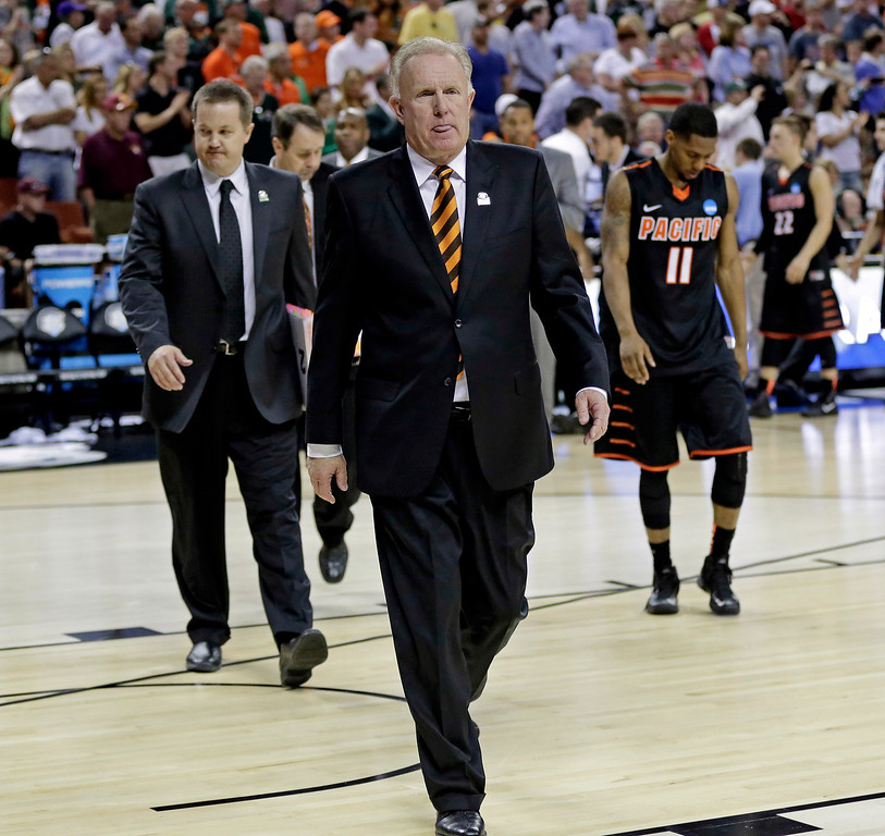 . Pacific head coach Bob Thomason walks off the court after a second-round game of the NCAA college basketball tournament against the MiamiFriday, March 22, 2013, in Austin, Texas. Miami beat Pacific 78-49. (AP Photo/Eric Gay)