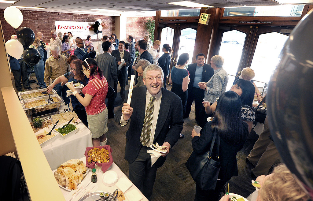 Description of . Frank Girardot, Pasadena Star-News Editor at Los Angeles Newspaper Group with his chopsticks and a plate of sushi at the grand opening of Star-News Lounge Tuesday, March 13, 2013.  After a nearly 130-year relationship with Pasadena, the Star-News will renew its vows of serving the community Tuesday at the grand opening of the Star-News Lounge. (SGVN/Photo by Walt Mancini/SXCity)