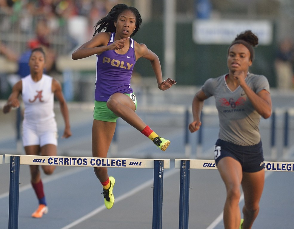 . NORWALK, CALIF. USA -- Poly\'s Kimber Payne competes in the 300 meter hurdles during the CIF-SS Masters Track and Field Meet in Norwalk, Calif., on Friday, May 24, 2013. Photo by Jeff Gritchen / Los Angeles Newspaper Group