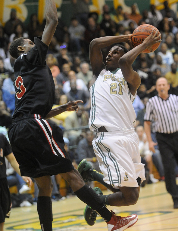 . 02-26-2012--(LANG Staff Photo by Sean Hiller)-Etiwanda beat Long Beach Poly 59-55 in Tuesday\'s CIF Southern Section Division 1AA semifinal boys basketball game at Long Beach Poly High School. Poly\'s Brandon Staton tries to shoot around Sheldon Blackwell (3).