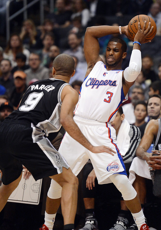 . The Clippers Chris Paul #3 looks to pass as the Spurs\' Tony Parker #9 defends during their game at the Staples Center in Los Angeles Friday, February  21, 2013. (Hans Gutknecht/Staff Photographer)