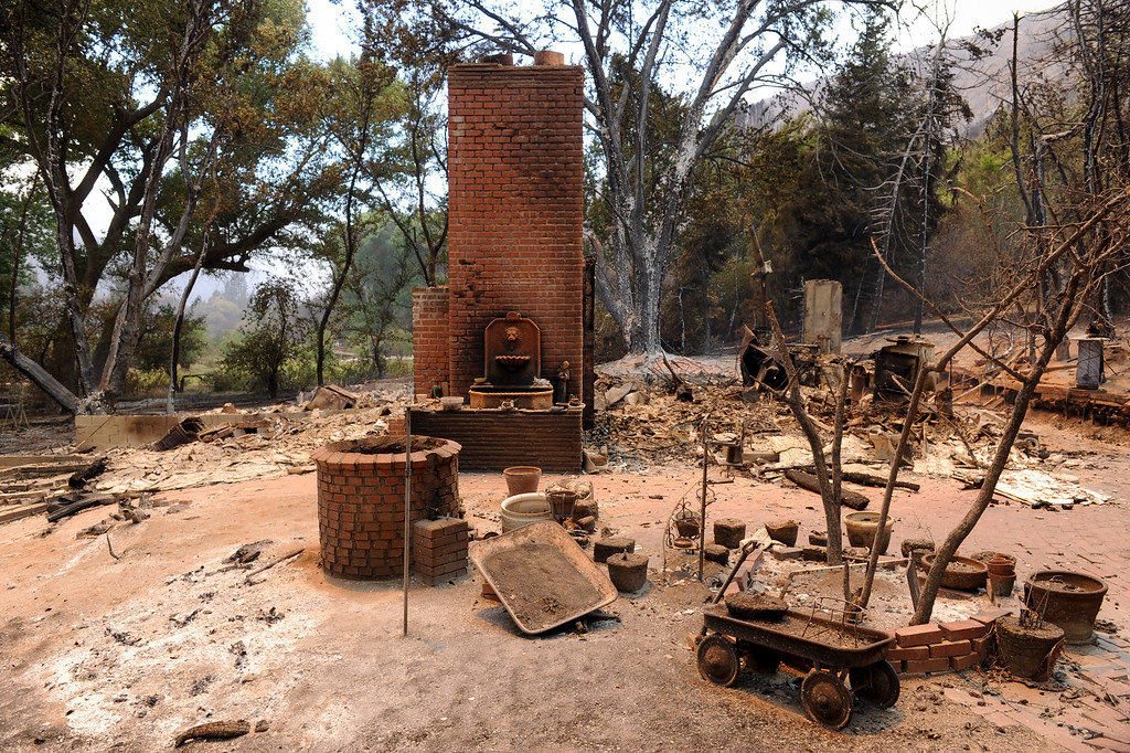 . A chimney is all that remains of a house in the 43300 block of Lake Hughes Road from the Powerhouse Fire, Sunday, June 2, 2013. (Michael Owen Baker/Staff Photographer)