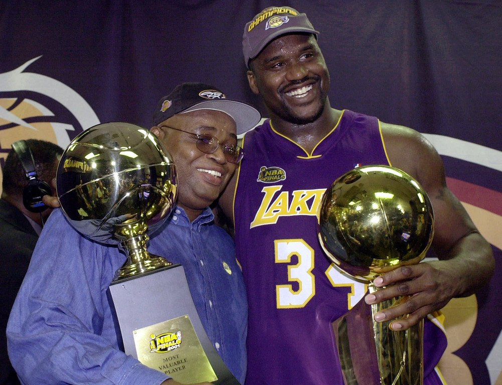 . Los Angeles Lakers\' Shaquille O\'Neal and his father, Phillip Harrison, celebrate after defeating the Philadelphia 76ers\' 108-96 in game 5 of the NBA finals to win their second straight NBA championship Friday June 15, 2001 in Philadelphia. (AP Photo/Mark J. Terrill)