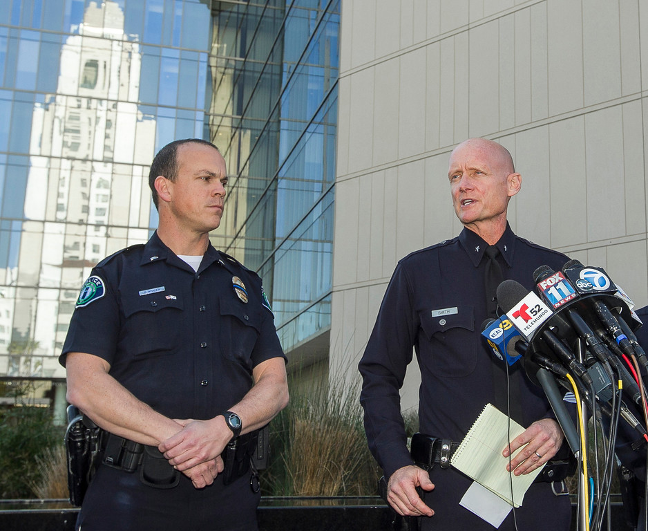 Description of . Los Angeles Police Commander Andrew Smith, right, briefs the media about the shootout scene in Big Bear that allegedly involves triple-murder suspect Christopher Jordan Dorner, during a news conference in front of the Police Administration Building in Los Angeles Tuesday, Feb. 12, 2013. At left,  Lt. Bill Whalen of the Irvine Police Department. (AP Photo/ Dovarganes)