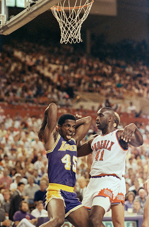 . Los Angeles Lakers A.C. Green (45) lets out a yell as he beats Phoenix Suns Mark West to a loose ball during action in their second-round NBA playoff game, Saturday, May 12, 1990, Phoenix, Az. (AP Photo/Jeff Robbins)