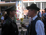 This photo was a classic. The young Bavarian guy tried so hard to get the police officer to take the rose - really sweet.