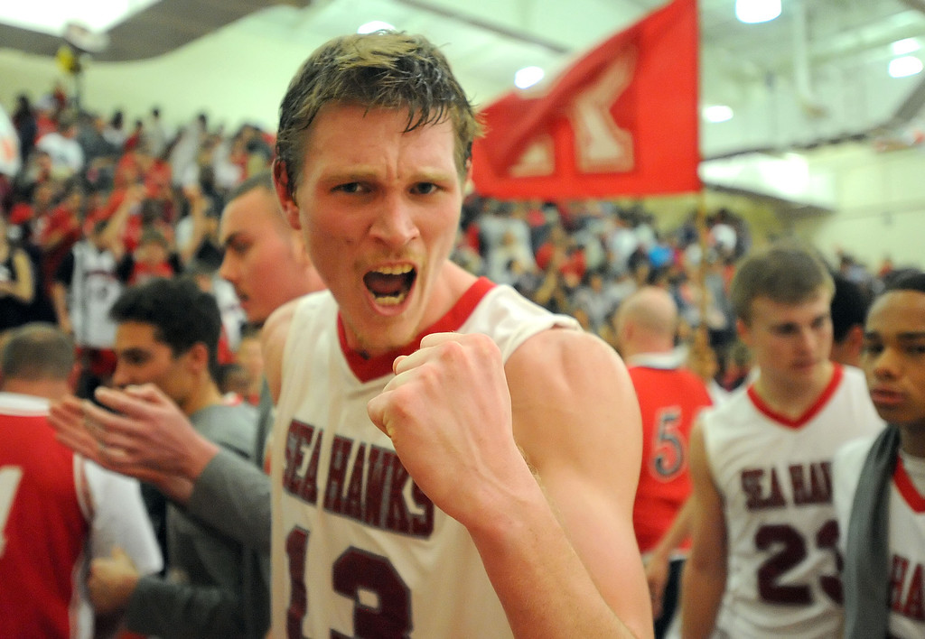 . Redondo Union\'s Sebastian Lindner (13) cheers his team\'s 55-41 win over Arroyo Grande in a CIF Southern Section Division II-A semifinal boys basketball game Tuesday night in Redondo Beach. 20130226 Photo by Steve McCrank / Staff Photographer