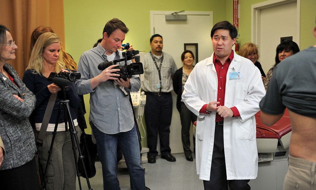 . 2/14/13 - Associate Medical Director Dr. Tyler Seto speaks to guests touring the new cardiopulmonary lab at the Long Beach Comprehensive Health Center.  The new lab was funded by more than $6000,000 grant from the Port of Long Beach Community Mitigation Grant Program.  According to Dr. Seto this will allow community members to have tests done within weeks instead of up to six months using other labs. Photo by Brittany Murray / Staff Photographer