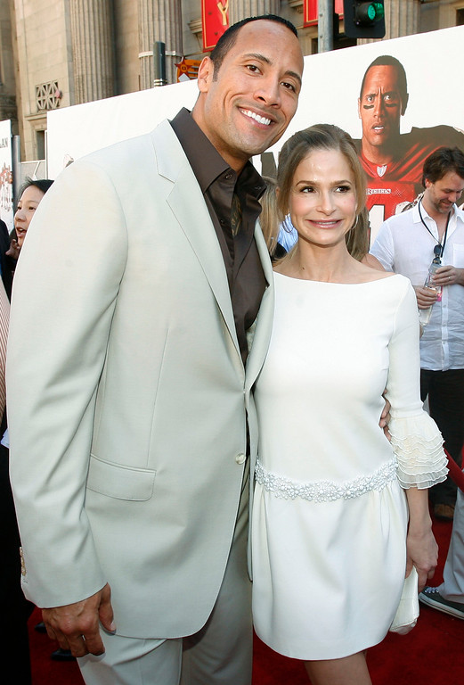 ". Dwayne ""The Rock\"" Johnson, left, and Kyra Sedgwick pose together at the premiere of \""The Game Plan\"" in Los Angeles on Sunday, Sept. 23, 2007. (AP Photo/Matt Sayles)"