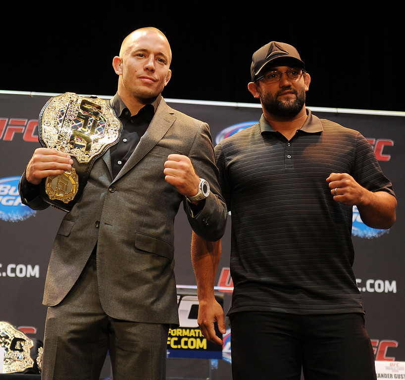 . UFC welterweight champion George St-Pierre poses with challenger Johny Hendricks during the UFC World Tour at Club Nokia Tuesday, July 30, 2013 in Los Angeles. (Hans Gutknecht/Los Angeles Daily News)