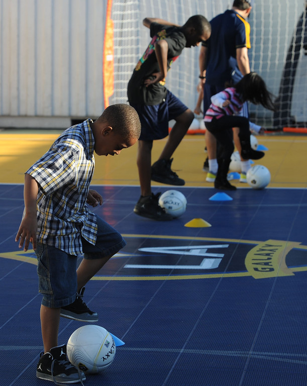 . The L.A. Galaxy unveiled a new Sport Court at the Boys and Girls Club of Carson Friday. In December, with the team heading to the championships, the LA Galaxy Foundation announced it would put in the court, donate equipment and host clinics, as the children were able to do after the unveiling. 20130301 Photo by Steve McCrank / Staff Photographer