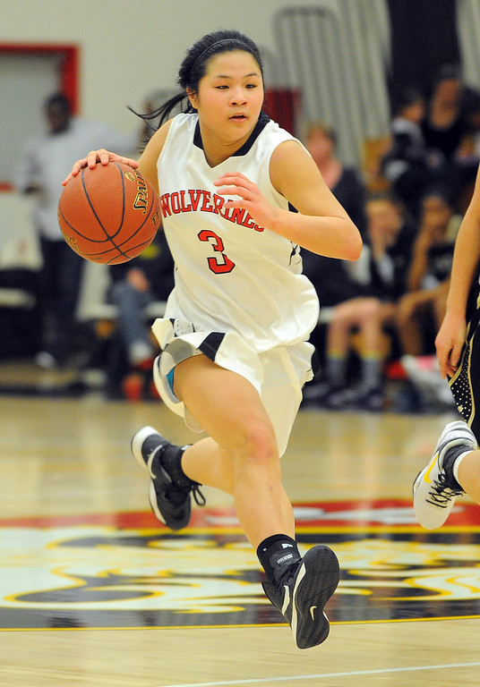 . STUDIO CITY - 02/16/13 - (Photo: Scott Varley, Los Angeles Newspaper Group)  CIF Southern Section Division IV-AA second-round girls basketball playoff game. Bishop Montgomery vs Harvard-Westlake. Bishop Montgomery won 57-42. H-W\'s Lindsey Tse drives the ball down the court.