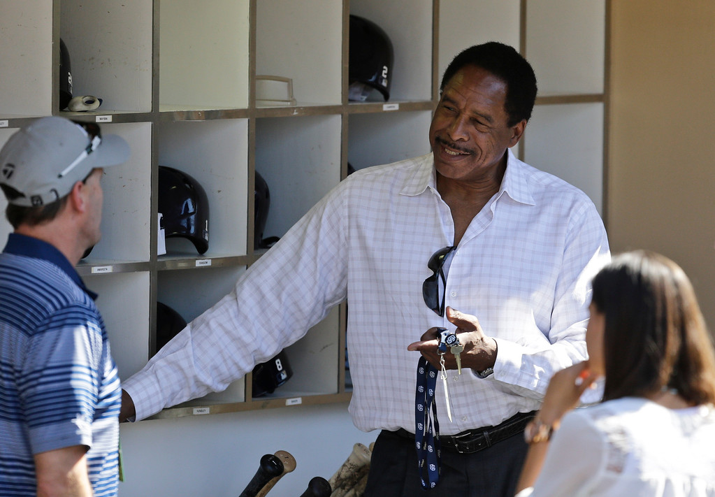 . Hall of Fame player Dave Winfield stands in the San Diego Padres dugout while talking to journalist prior a baseball game between the San Diego Padres and the Los Angeles Dodgers in San Diego, Wednesday, April 10, 2013. (AP Photo/Lenny Ignelzi)