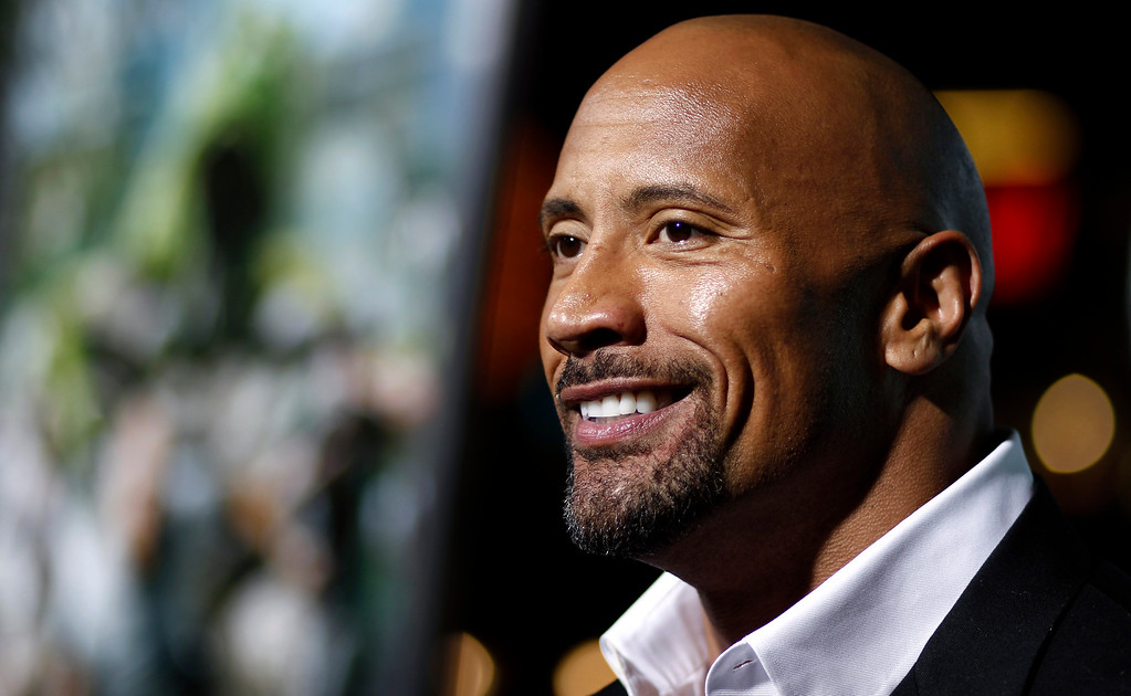 ". Cast member Dwayne ""The Rock\"" Johnson arrives at the premiere of \""Journey 2: The Mysterious Island\"" in Los Angeles, Thursday, Feb. 2, 2011.  \""Journey 2: The Mysterious Island\"" will be released Feb. 10, 2011.  (AP Photo/Matt Sayles)"