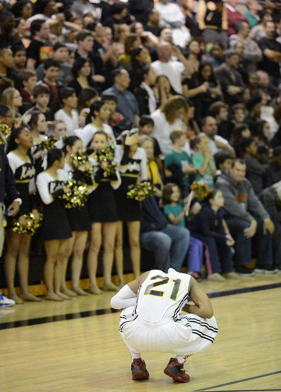 Description of . Bishop Montgomery's Justin Bibbins (21) reacts as La Verne Lutheran puts up more points with seconds left in a CIF SS Division IV-AA semifinal game in Torrance Friday night. Lutheran stunned Bishop Montgomery 63-59, ending their unbeaten season. 20130222 Photo by Steve McCrank / Staff Photographer