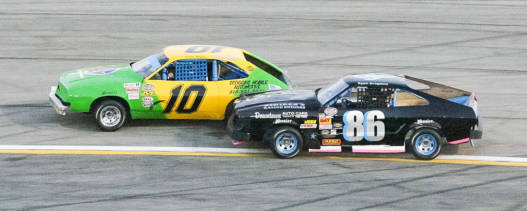 . Ryan Bragdon (86) attempts to pass Steve Roger (10) down low, during opening night  at Irwindale Speedway Saturday April 6, 2013. (Correspondent photo by Chris Burt)