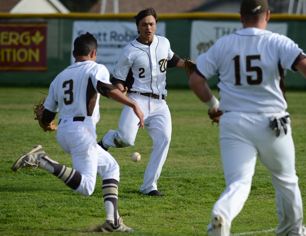 . A Torrance hit drops in right field on West\'s Javier Galvan (3), Kevin Clausen (2) and Tommy Oslund (15) in a non league baseball game at West. After a scoreless game through five, West went on to win 7-4. 20130314 Photo by Steve McCrank / Staff Photographer