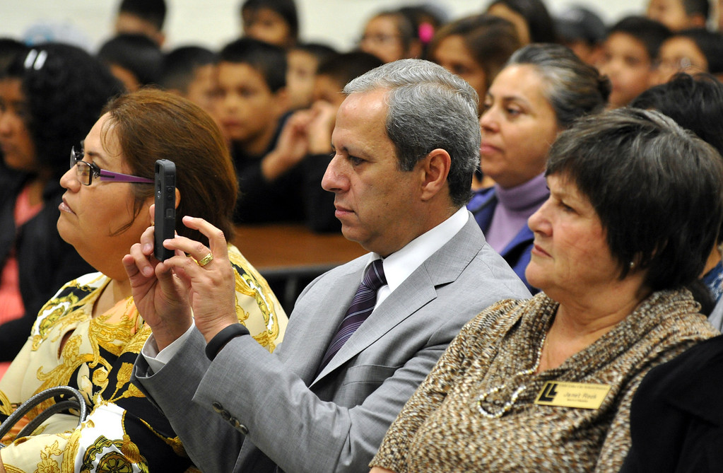 . Little Lake School District Superintendent, Phillip Pérez. takes a picture as Medal of Freedom recipient Sylvia Mendez speaks to students at Jersey Avenue Elementary School in Santa Fe Springs on Thursday March 21, 2013. Mendez is the daughter of Gonzalo Mendez, a Mexican immigrant and Felicitas Mendez, a Puerto Rican immigrant, who fought so that their daughter could have an equal education through the landmark court case battle of Mendez v. Westminster in the 1940s. In 2011, Sylvia was awarded the Medal of Freedom by President Obama. (SGVN/Staff Photo by Keith Durflinger)