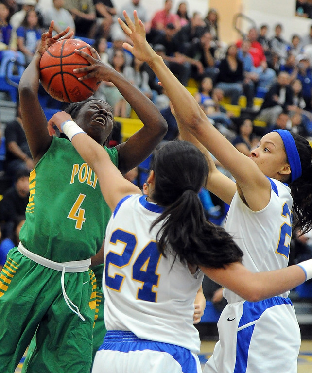 Description of . \tp4n\ drives to the basket against Bishop Amat's Jennifer Vasquez (24) in the first half of a CIF State Southern California Regional semifinal basketball game at Bishop Amat High School on Tuesday, March 12, 2013 in La Puente, Calif. Long Beach Poly won 52-34.  (Keith Birmingham Pasadena Star-News)