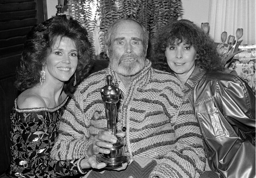 ". Actor Henry Fonda poses with the Oscar he won for his performance in ""On Golden Pond\"" at his home in Bel Air, Ca., late Monday night, March 29, 1982.  At left is his daughter, actress Jane, and at right is his wife, Shirlee.  Fonda is too ill to have attended the Academy Awards ceremony.  (AP Photo/Wally Fong)"