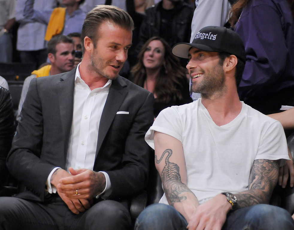 . David Beckham and Adam Levine on the sidelines.The Los Angeles Lakers lost to the Dallas Mavericks 99-91 in the opening game of the 2012-2013 NBA Season. Los Angeles, CA 10/30/2012 (photos by John McCoy/Staff Photographer)