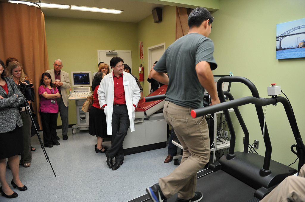 . 2/14/13 - Associate Medical Director Dr. Tyler Seto watches Javier Ramos on the treadmill in the new cardiopulmonary lab at the Long Beach Comprehensive Health Center.  The new lab was funded by more than $6000,000 grant from the Port of Long Beach Community Mitigation Grant Program.  According to Dr. Seto this will allow community members to have tests done within weeks instead of up to six months using other labs. Photo by Brittany Murray / Staff Photographer