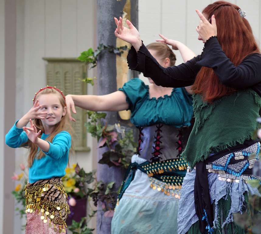 ". Melody Yates looks at her mother as they dance during Shakespeare Festival and performance of ""Much Ado About Nothing\"" at Whittier Christian High School in La Habra on Wednesday April 24, 2013. The festival included food booths, crafts, juggling, music and an open air performance on the lawn. (SGVN/Staff Photo by Keith Durflinger)"