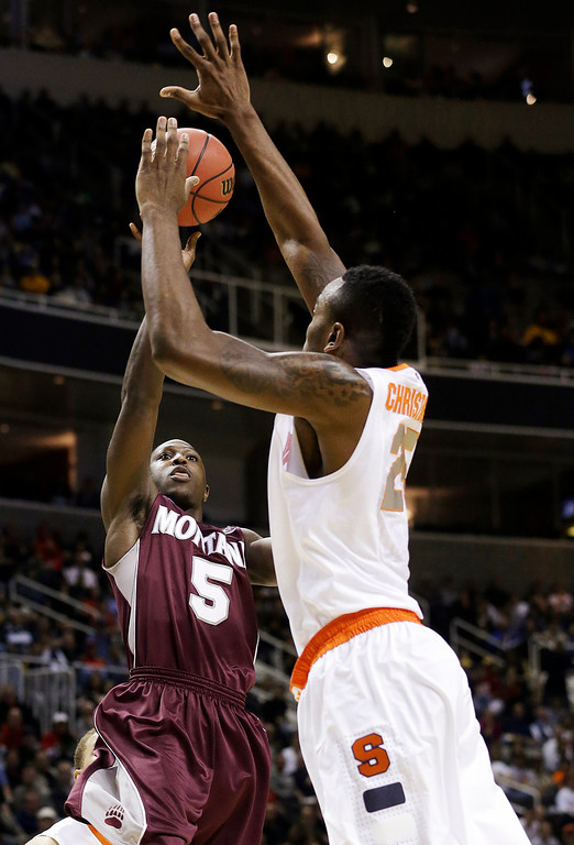 . Montana guard Will Cherry (5) shoots against Syracuse forward Rakeem Christmas (25) during the first half of a second-round game in the NCAA college basketball tournament in San Jose, Calif., Thursday, March 21, 2013. (AP Photo/Jeff Chiu)
