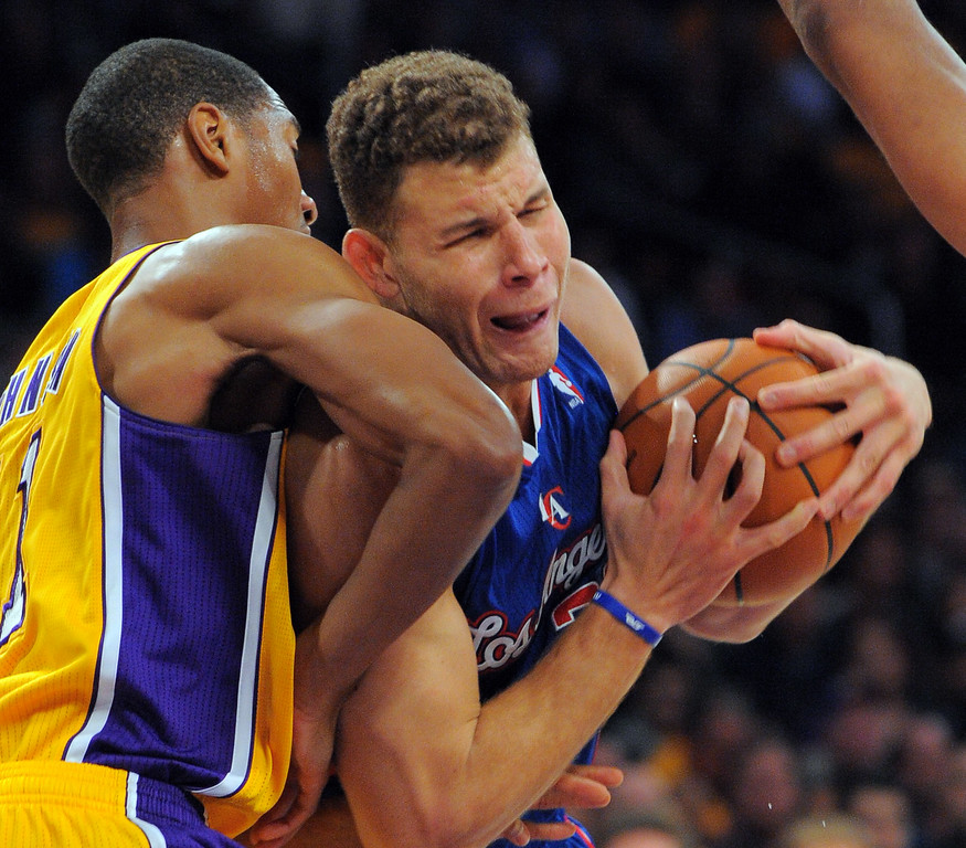 . Clippers Blake Griffin is pressured under his basket by Wesley Johnson in the NBA season opener between the Lakers and Clippers at Staples Center in Los Angeles, CA on Tuesday, October 29, 2013.  Lakers won 116-103. (Photo by Scott Varley, Daily Breeze)