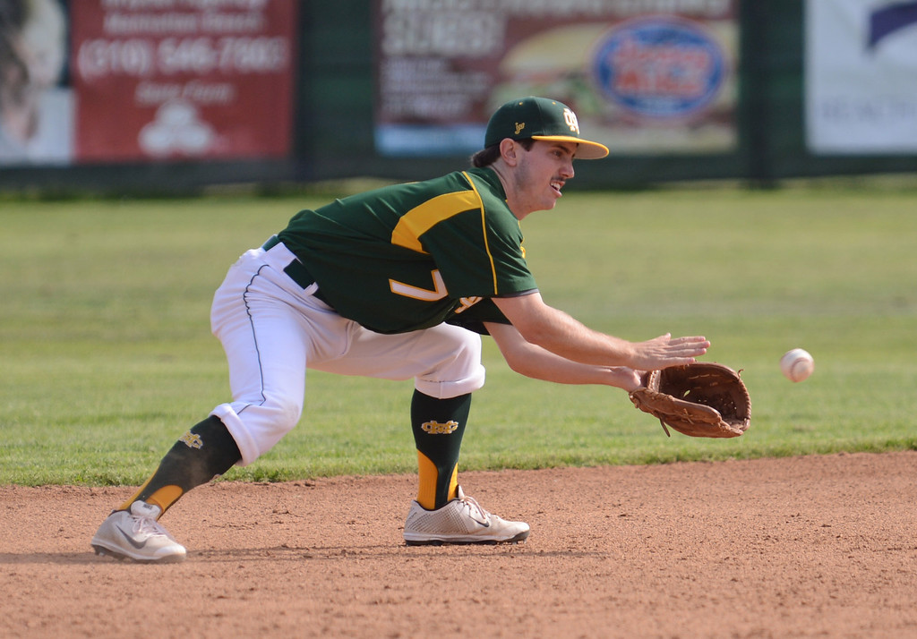 . MC shortstop Jack Hadley with a catch. Mira Costa defeated Westchester 2-1 at home in boy\'s baseball.  Photo by Brad Graverson 3-26-13