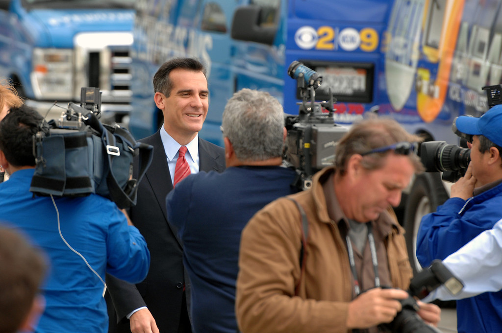 . Media surround mayoral candidate Eric Garcetti walking to  the podium at a press conference at Van de Kamp\'s Innovation Campus in Los Angeles, Wednesday, March 6, 2013. (Michael Owen Baker/Staff Photographer)