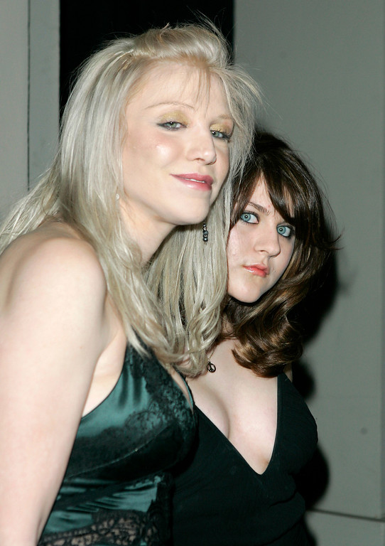 Description of . Singer Courtney Love and her daughter Frances Bean Cobain pose as they arrive, Thursday, Feb. 8, 2007, in Beverly Hills, Calif. where the City of Beverly Hills and the Rodeo Drive Committee honored Gianni Versace and his sister Donatella Versace for their contributions to the worlds of fashion and entertainment with the Rodeo Drive Walk of Style Award. Versace, founded in 1978 by Gianni Versace, is one of the leading international fashion design houses and a symbol of Italian luxury worldwide.  (AP Photo/Mark J. Terrill)