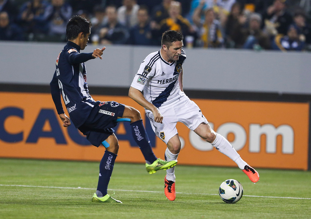. Los Angeles Galaxy forward Robbie Keane, right, and Monterrey defender Severo Meza during the CONCACAF Champions League semifinal, Wednesday, April 3, 2013, in Carson, Calif. Monterrey won 2-1. (AP Photo/Bret Hartman)