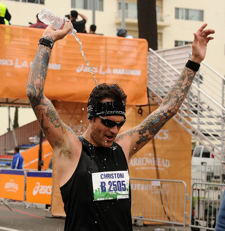 . LA marathon runners cheer as the cross the finish line during the 2013 LA Marathon. Santa Monica March 17,2013. Los Angeles Photo by Gene Blevins/LA DailyNews