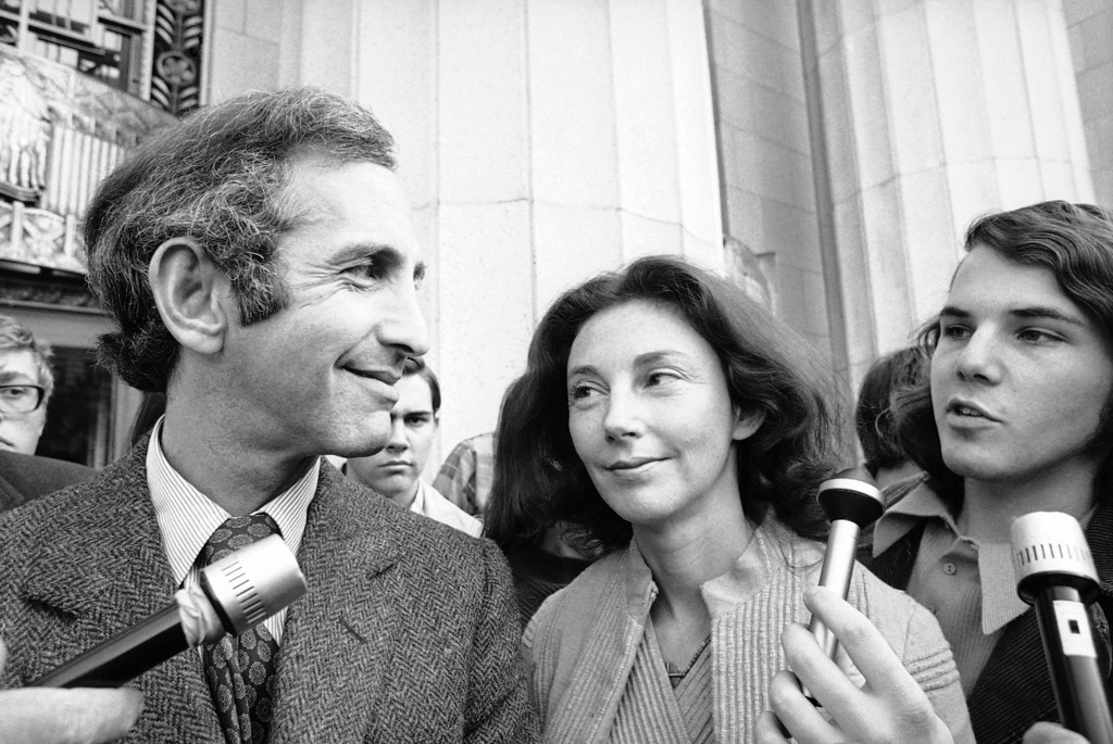 Description of . In this Wednesday, April 12, 1973 photo, Daniel Ellsberg, co-defendant in the Pentagon Papers trial, talks with newsmen after he testified in Los Angeles. Next to him is his wife, Patricia. Ellsberg, who vividly described his journey to disillusionment in Vietnam on Wednesday, will climax that story on Thursday, telling jurors how he risked his government career to copy the Pentagon Papers, hoping to end the war. As the last U.S. combat troops left Vietnam 40 years ago, angry protesters still awaited them at home. North Vietnamese soldiers took heart from their foes' departure, and South Vietnamese who had helped the Americans feared for the future. While the fall of Saigon two years later — with its indelible images of frantic helicopter evacuations — is remembered as the final day of the Vietnam War, Friday marks an anniversary that holds greater meaning for many who fought, protested or otherwise lived it.  (AP Photo)