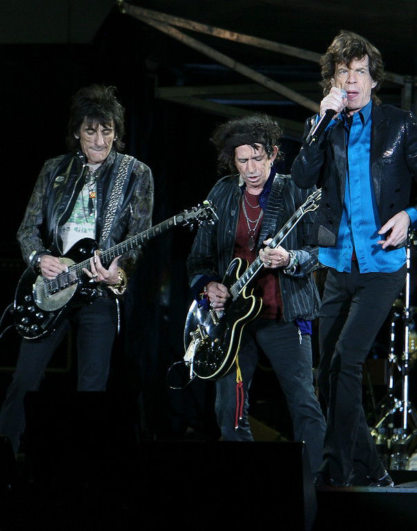 ". The Rolling Stones perform during a concert on their ""A Bigger Bang\"" tour in Warsaw, Poland, Wednesday, July 25, 2007. The British group went ahead with their concert despite a three day period of national mourning in Poland after 26 Polish pilgrims died in a bus crash in France. (AP Photo/Czarek Sokolowski)"