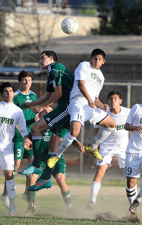 . March 4,2013. Canoga Park. Canoga Park #16 Rony Ventura(R.) tries to deflect the ball away from the net, as Canoga took the win 2-0 over  Coronado high during the first round of Southern California Div. II boys soccer regional playoffs   Photo by Gene Blevins/LA DailyNews