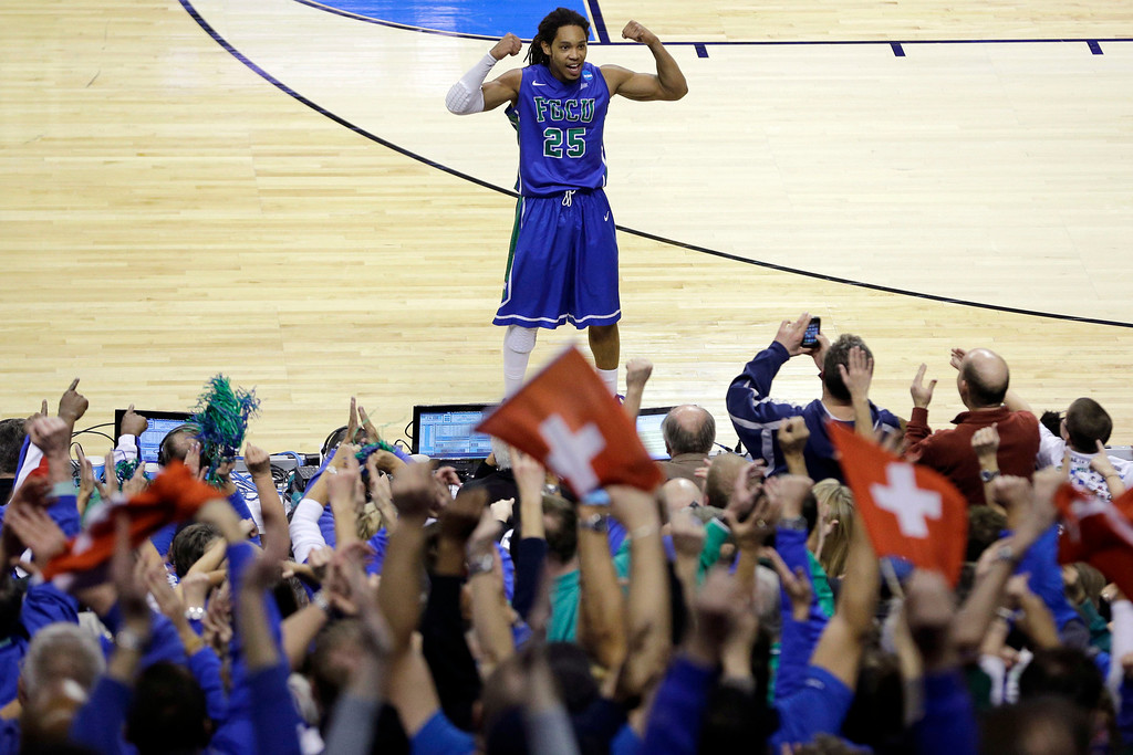 . Florida Gulf Coast\'s Sherwood Brown celebrates with fans during the final minute of a second-round game against Georgetown in the NCAA college basketball tournament on Friday, March 22, 2013, in Philadelphia. Florida Gulf Coast won 78-68. (AP Photo/Matt Slocum)