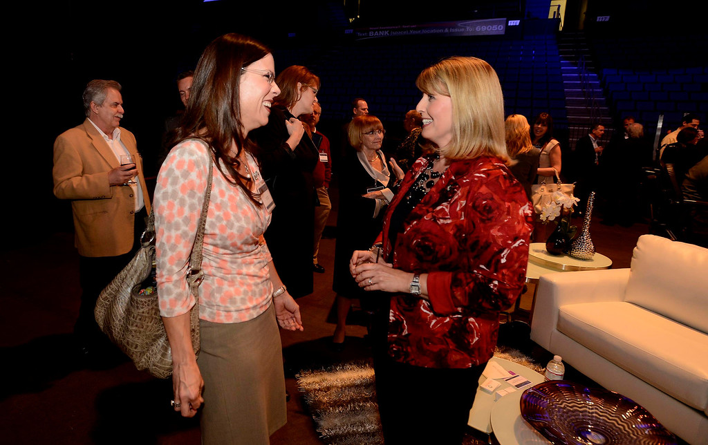 . City of Fontana assistant to the City Manager Amy Colbrunnn, left, speaks with Supervisor Janice Rutherford networking forum after the State of the County 2013 program at Citizens Bank Arena in Ontario April 10, 2013.   GABRIEL LUIS ACOSTA/STAFF PHOTOGRAPHER.