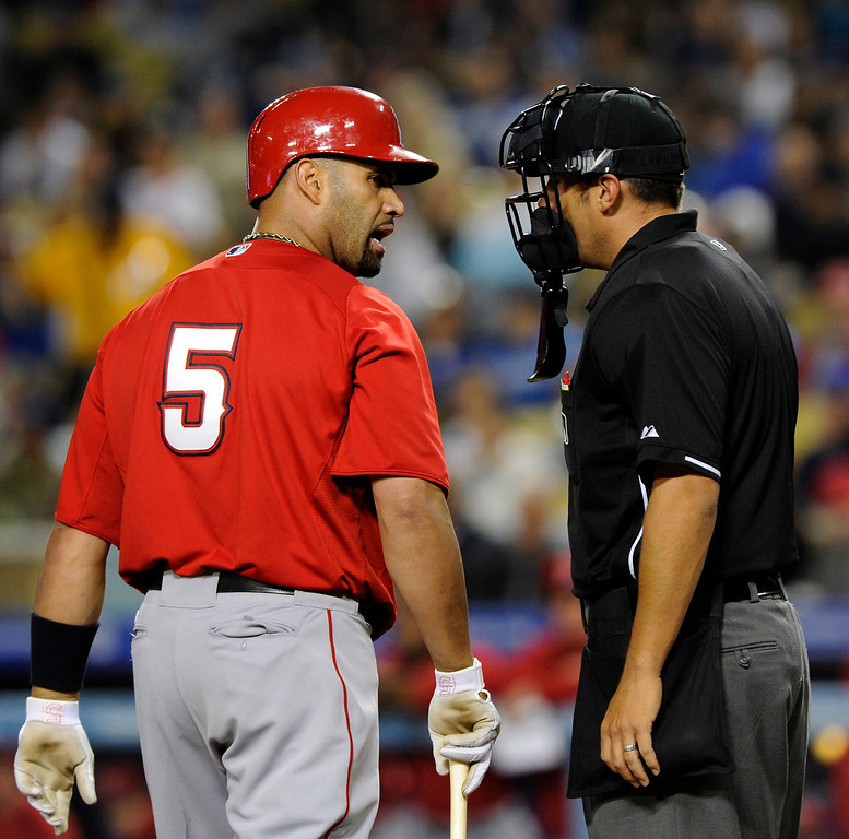 . The Angels\'  Albert Pujols has words with the home plate umpire after being called out on strikes in the third inning, Friday, March 29, 2013, at Dodger Stadium. (Michael Owen Baker/Staff Photographer)