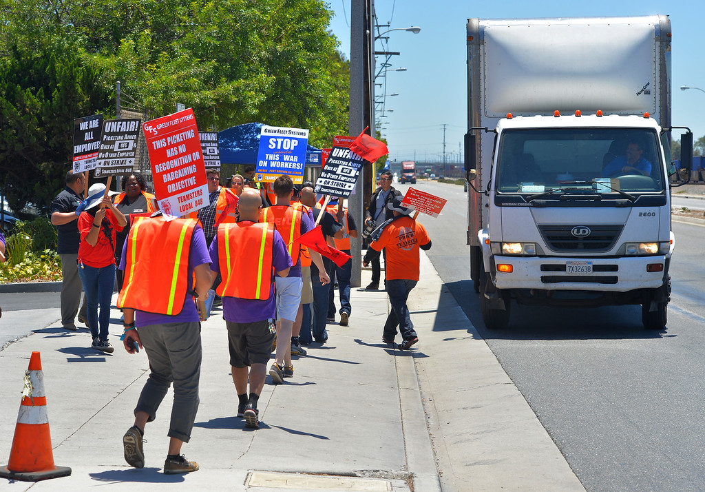 . United Farm Workers join Teamsters as they delay a truck from entering Green Fleet Systems in Carson, CA on Monday, July 7, 2014. Truckers picketed several trucking companies and shipping terminals at the ports of Long Beach and Los Angeles claiming they are treated unfairly and are demanding better pay and working conditions. (Photo by Scott Varley, Daily Breeze)
