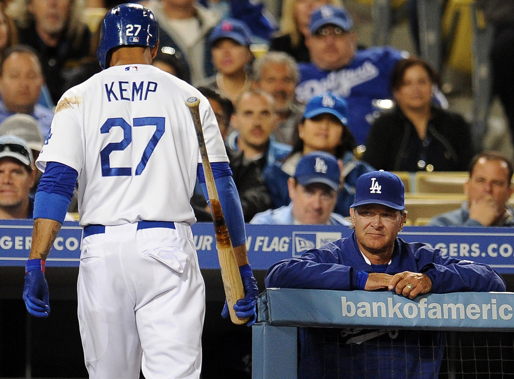 . Los Angeles Dodgers\' Matt Kemp (27) walks back into the dugout after striking out swinging with the bases loaded as manager Don Mattingly looks on in the seventh inning of their baseball game against the San Diego Padres on Wednesday, April 17, 2013 in Los Angeles.   (Keith Birmingham/Pasadena Star-News)