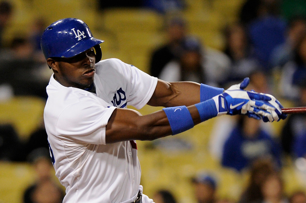 . Dodgers rookie outfielder Yasiel Puig swings at a pitch against the Angels, Friday, March 29, 2013, at Dodger Stadium. (Michael Owen Baker/Staff Photographer)