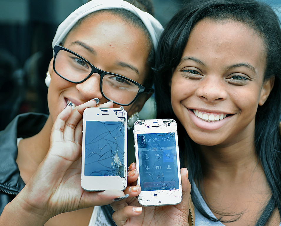 Description of . Lexi Cooper, left, of Arcadia  and Kihilyn Craig of Monrovia at Apple Store in Old Pasadena waiting in line  to replace their old IPhones that have been through hell & back  with the release of the new IPhone 5S and IPhone 5C Friday, September 20, 2013. (Photos by Walt Mancini/Pasadena Star-News)