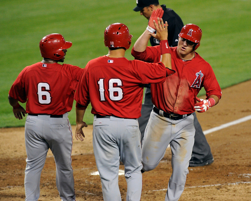 . The Angels\' Mike Trout, right, is congratulated after hitting a a three run homer against the Dodgers in the fourth inning, Friday, March 29, 2013, at Dodger Stadium. (Michael Owen Baker/Staff Photographer)