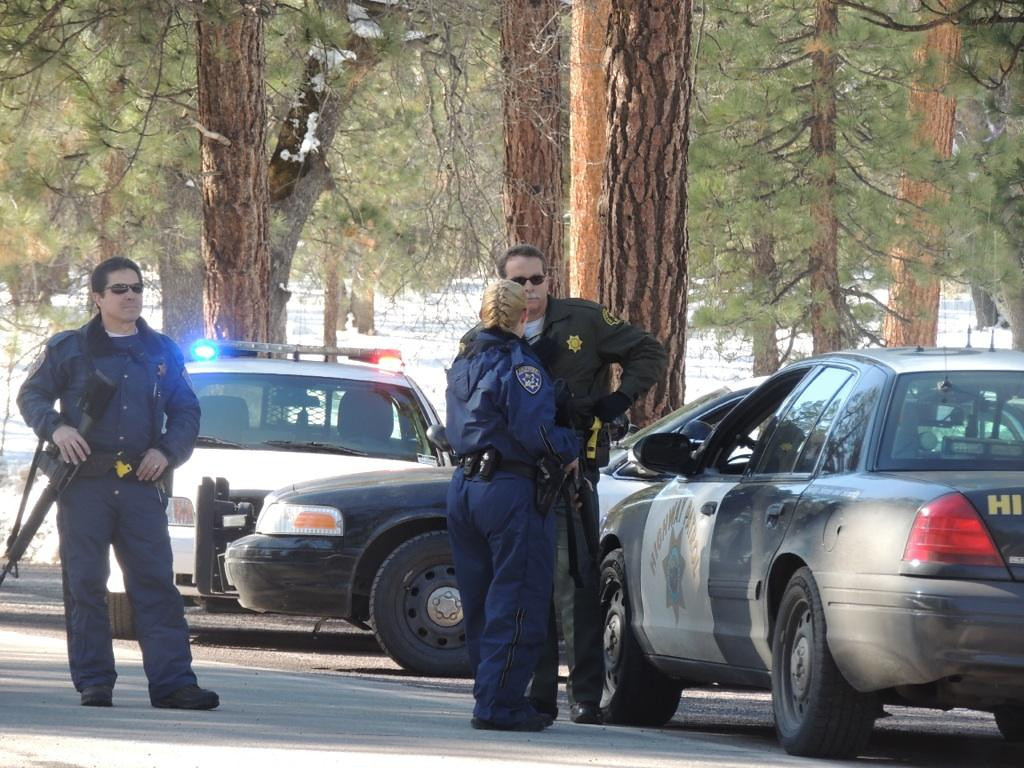 . CHP & paramedics race to the scene of a possible fugitive Christopher Dorner sighting near Highway 38 by Braton Flatts In the San Bernardino Mountains on Tuesday, Feb. 12, 2012. (Rachel Luna / Staff Photographer)
