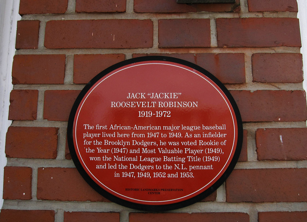 "Description of . This April 7, 2013 photo shows a plaque on a house in the Brooklyn borough of New York, where baseball great Jackie Robinson once lived. The sign says: ""The first African-American major league baseball player lived here from 1947 to 1949."" A new movie, ""42,"" tells Robinson's inspiring story as the man who integrated Major League Baseball. The house at 5224 Tilden Ave. in East Flatbush is one of a number of places in Brooklyn connected to Robinson. (AP Photo/Beth J. Harpaz)"