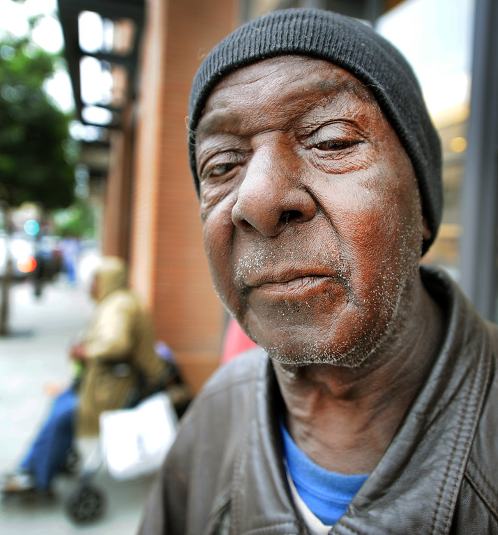 . Thomas Williams, homeless, was driven to Pasadena from Los Angeles with 6-7 homeless people and spent overnight waiting in line at the Apple Store in Old Pasadena to purchase 2 IPhones for a buyer. He was to be paid $40 by the buyer but never received payment. Police detained three people after a fight erupted outside Apple Store, where a crowd waited overnight for release of the new iPhone. The fight was over homeless people who were promised $40 and didn\'t get paid, to wait overnight to purchase IPhones for a buyer.(Photos by Walt Mancini/Pasadena Star-News)
