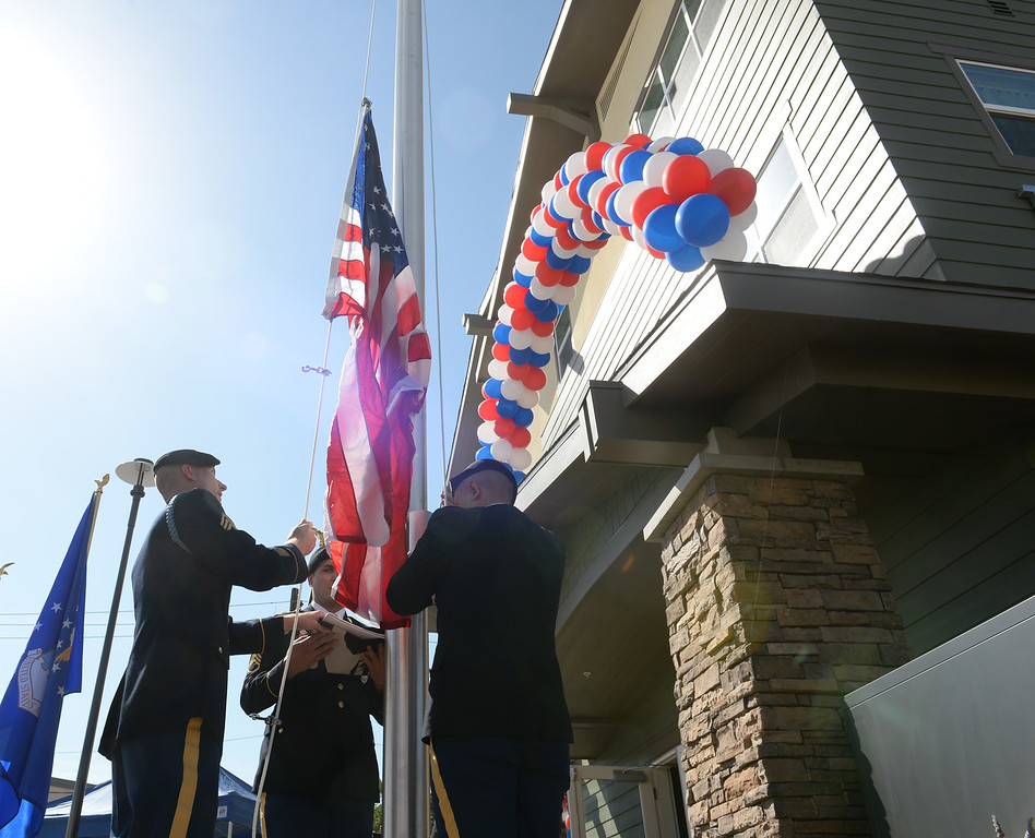Description of . The El Monte Army Career Center Color Guard raise the flags during the Grand Opening of the El Monte Veterans Village on Ramona Blvd. in El Monte on Wednesday March 12, 2014. The Veterans Village is a state-of-the-art veterans housing community includes 40 studio apartments. (Staff Photo by Keith Durflinger/San Gabriel Valley Tribune)